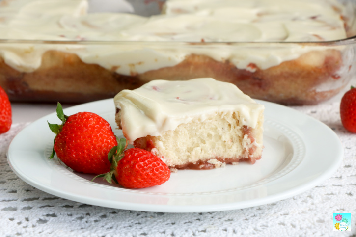 Strawberry Cinnamon Roll on plate with fresh strawberries