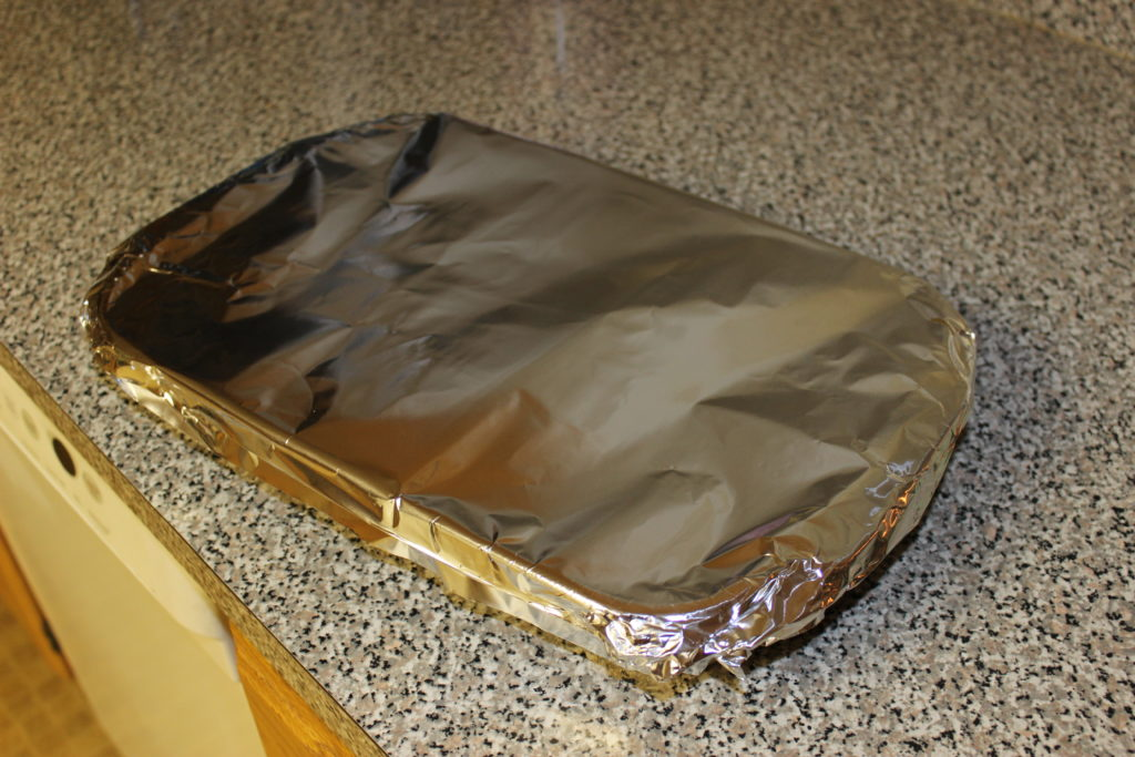Casserole covered with aluminum foil