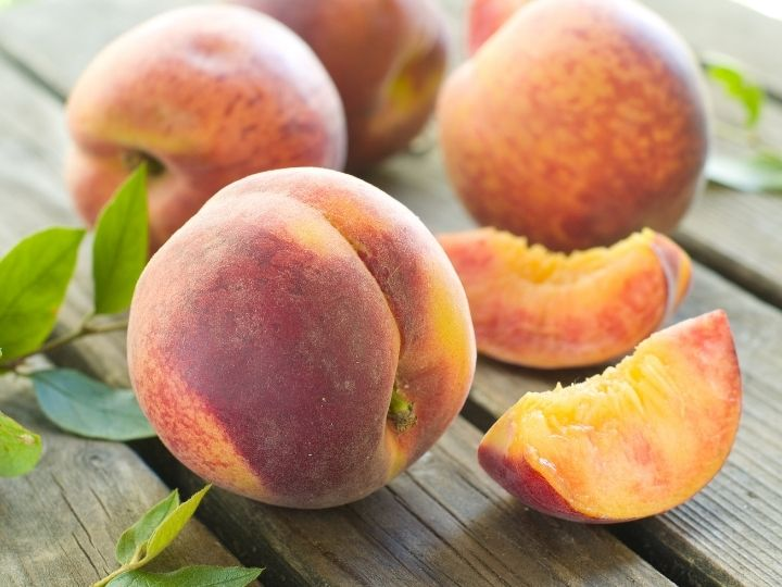 fresh peaches on table